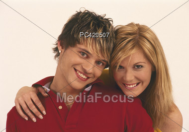 Young Couple, Her Hand On His Shoulder Stock Photo