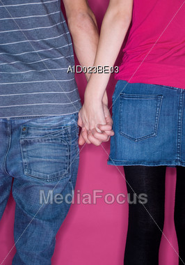 Young Couple, Holding Hands Stock Photo