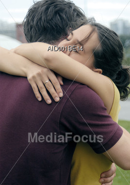 Young Couple Hugging Stock Photo