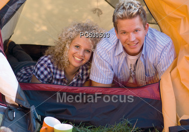 Young Couple In Camping Tent Stock Photo