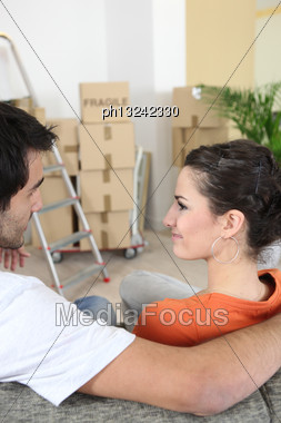 Young Couple In New Apartment Stock Photo