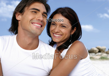 Young Couple in White Shirts Stock Photo