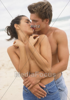 Stock Photo Young Couple Kissing He Shirtless Holding Image 61012