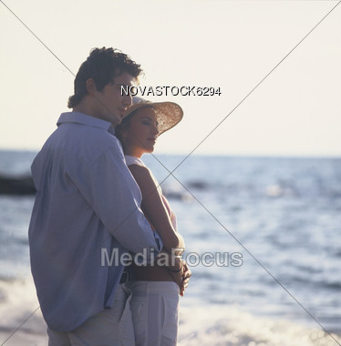 Young Couple on Beach Vacation Stock Photo