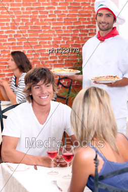 Young Couple On A Date In A Pizzeria Stock Photo