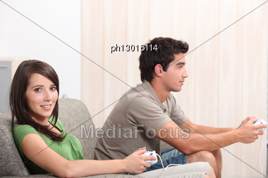 Young Couple Playing Computer Games Stock Photo