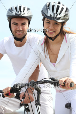 Young Couple Riding Bicycles Stock Photo