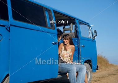 Young Couple Sitting in an old Bus Stock Photo