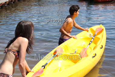 Young Couple With Boat Stock Photo