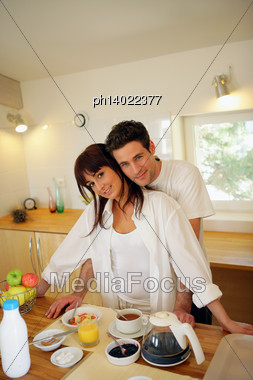 Young Couple With Breakfast Stock Photo
