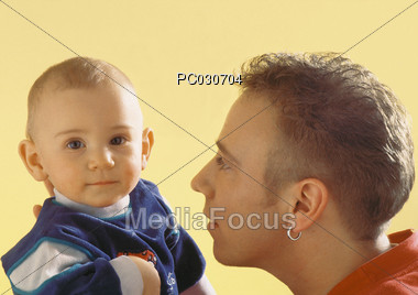 Young Dad with Baby Stock Photo
