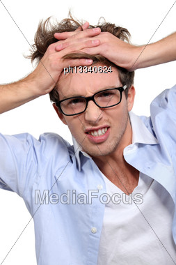 Young Employee Under Pressure Stock Photo
