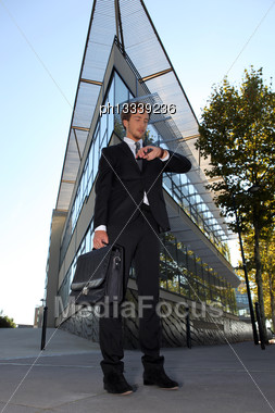 Young Executive Waiting Outside A Modern Building Stock Photo