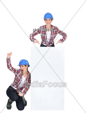 Young Female Duo Wearing Blue Safety Helmet Against White Background Stock Photo