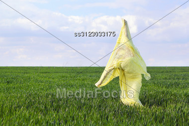 Young Flexible Woman Wrapped In Yellow Cloth Stock Photo