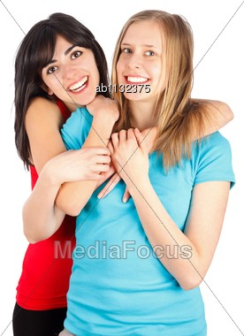 Young Friends Being Happy, Hugging And Smiling Stock Photo