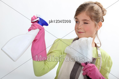 Young Girl Cleaning Stock Photo