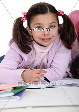 Young Girl Doing Her Homework Stock Photo