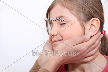 Young Girl Enjoying A Massage Stock Photo