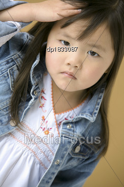 Young Girl Frowning Stock Photo