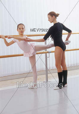 Young Girl Learning Ballet Stock Photo