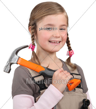 Young Girl With A Hammer Stock Photo