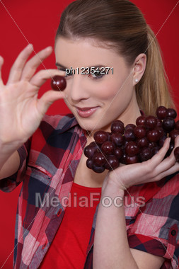 Young Girl With Bunches Of Grapes Stock Photo