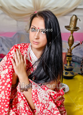 Young Indian Girl In Traditional Red Clothing With Hookah Stock Photo