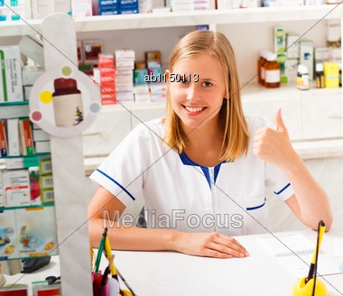 Young Kind Pharmacist Being Contented With Her Occupation Stock Photo
