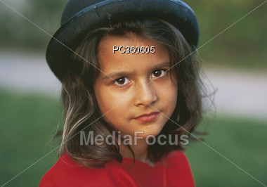 Young Latin Girl with Hat Stock Photo