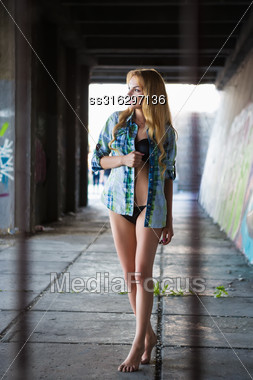 Young Leggy Smiling Blond Woman Posing In Underwear And Shirt Stock Photo