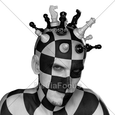 Young Male With Chess King Head Stock Photo