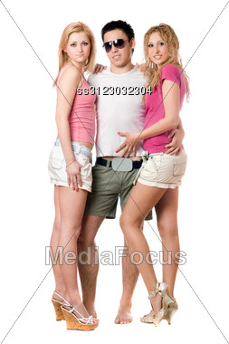 Young Man And Two Pretty Girls. Stock Photo