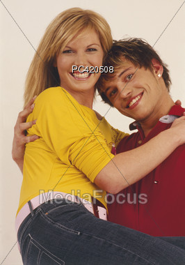 Royalty-Free Stock Photo: Young Man Carrying Woman