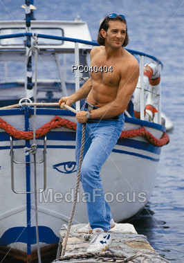 Male Docking http://www.mediafocus.com/stock-photo-young-man-docking-boat-pc040404.html