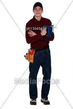 Young Man Holding A Jigsaw Stock Photo