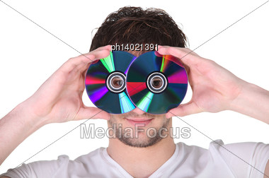 Young Man Holding Compact Discs To His Face Stock Photo