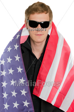 Young Man In The American Flag. Isolated Stock Photo