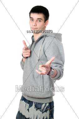 Young Man In Gray Sweatshirt With A Hood Stock Photo