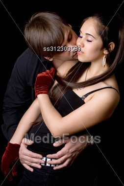 Young Man Kissing Pretty Woman. Stock Photo