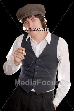 Young Man With A Malicious Smile Holding A Cigarette. Stock Photo