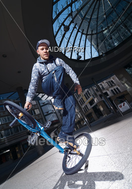 Young Man Performing Stunt on Trick Bike Stock Photo