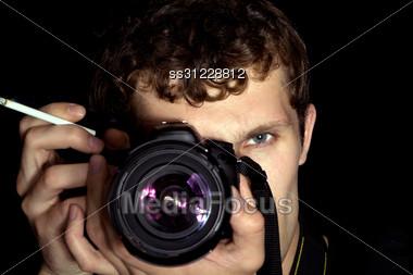 Young Man - Photographer Behind Work. Stock Photo