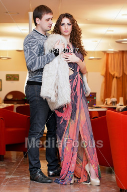Young Man And A Pretty Girl In Restaurant Stock Photo