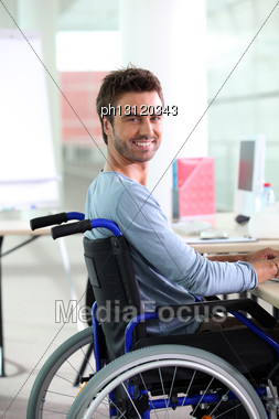 Young Man Smiling In Wheelchair Stock Photo
