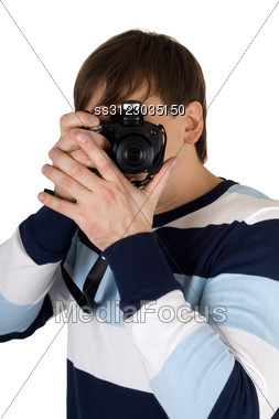 Young Man With A Camera. Stock Photo
