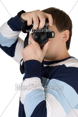 Young Man With A Digital Camera. Stock Photo