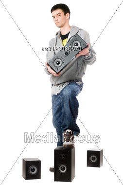 Young Man With A Four Speakers. Stock Photo