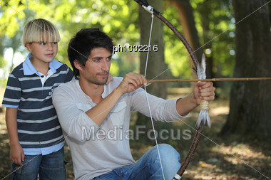 Young Man With Archer And Kid Stock Photo