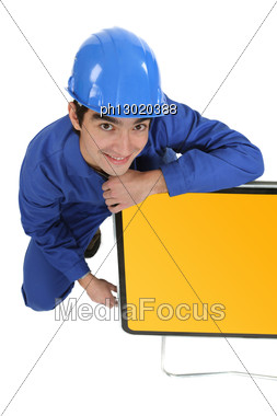 Young Man With A Blank Road Sign Stock Photo
